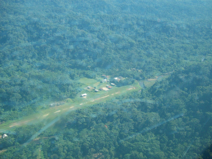"""After about 30 minutes, we saw """"Terminal City"""" on the left side of our plane. The runway is the dirt/grass/gravel path."""