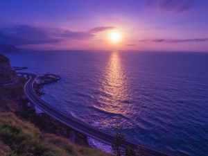 body of water across sunset